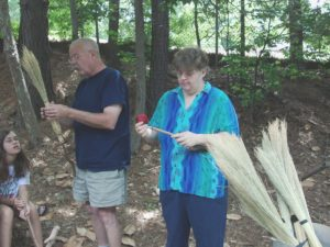 Mr. Williams demonstrating broom making