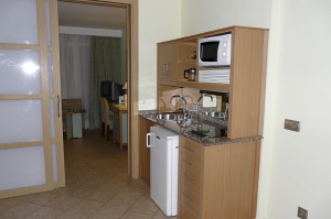 A nicely stocked hotel room kitchenette. Call the hotel in advance to see what amenities are included in your room.